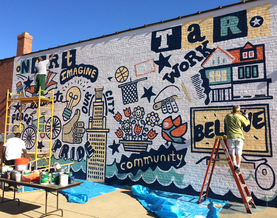 Mural in progress on East 55. Image courtesy of Christopher Darling